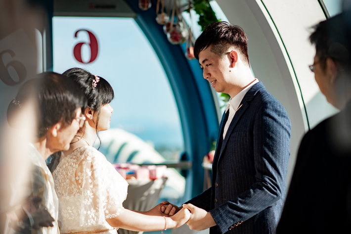 Exchanging of vows on top of Singapore Flyer